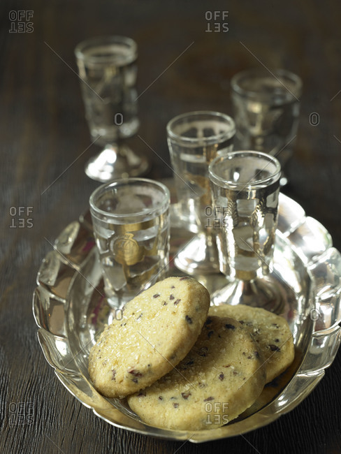 Cookies and small glasses on a silver platter
