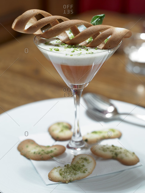 A cocktail served with pistachio chips