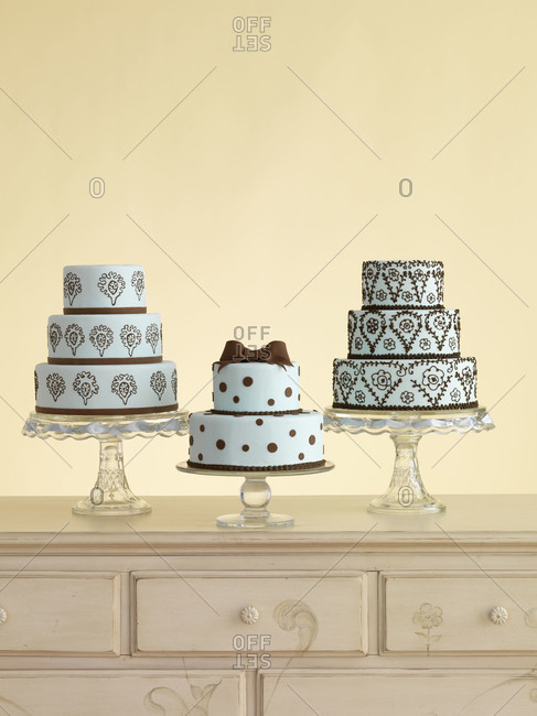 Three cakes on a dresser