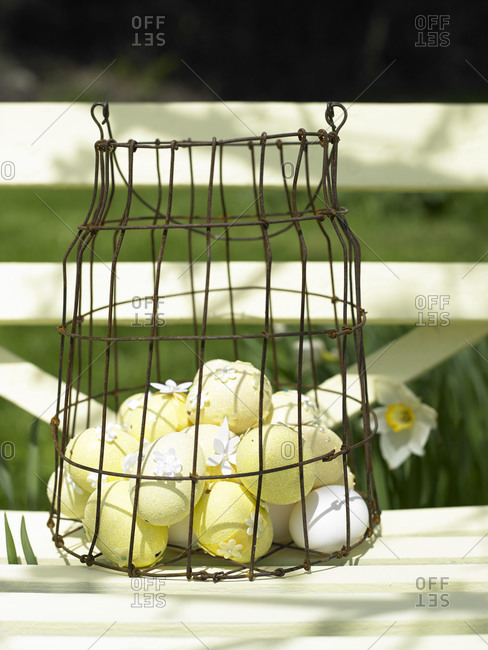 Sparkling eggs in a wire basket