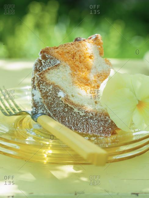 A slice of yellow bundt cake