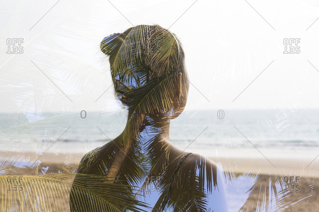 Back view of woman standing on a beach