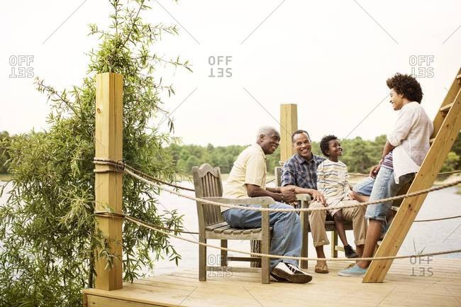 Men and boy chatting on dock