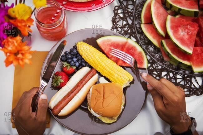 Man ready to eat picnic food
