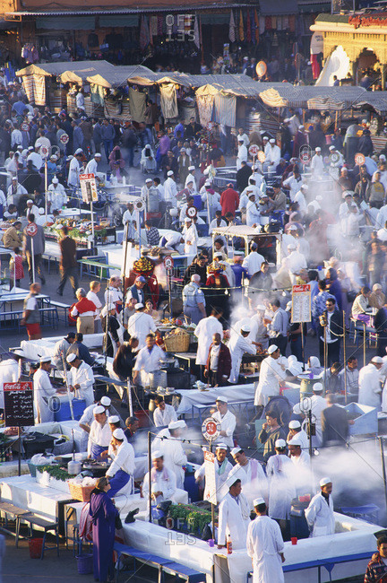 Marakesh, Morocco - May 18, 2007: Vendors in a crowded market