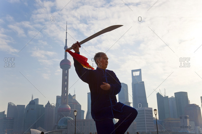 Shanghai,Chin - January 17, 2012: Man practicing Tai Chi in the early morning in Shanghai
