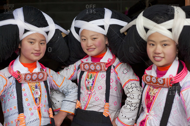 Sugao, China - January 31, 2012: Portrait of Long Horn Miao girls