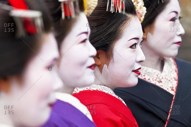 Kyoto, Japan - January 30, 2011: Geisha standing side-by-side