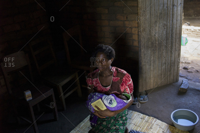 Ndallam Village, Malawi - April 30, 2013: A woman holds her baby after getting him tested for HIV