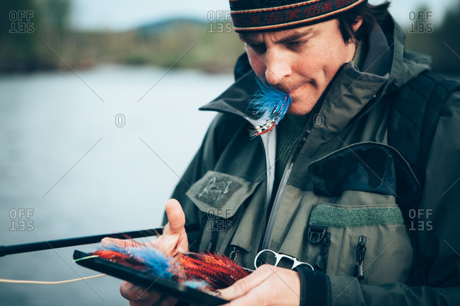 Fly-fisherman holding fishing tackle, close up, Olympic NP, WA, USA
