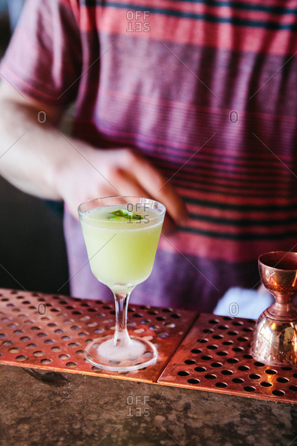 A drink is served at a bar