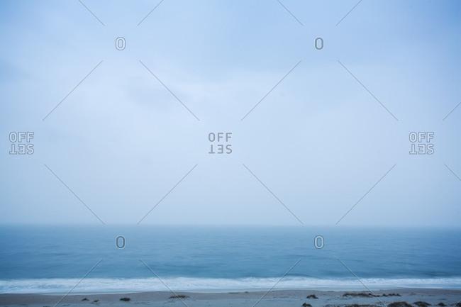 Fog over ocean waves