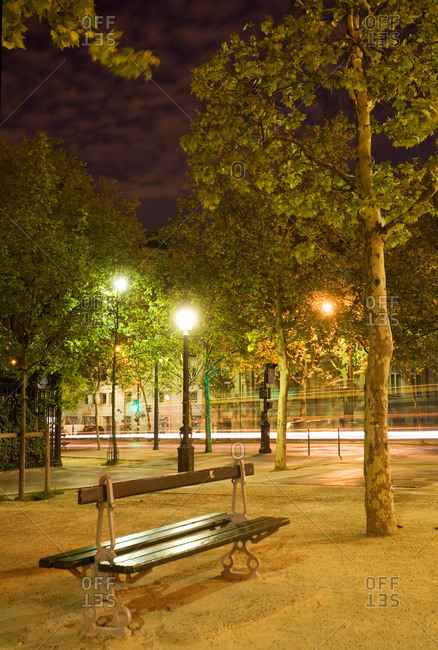 Paris park bench at night