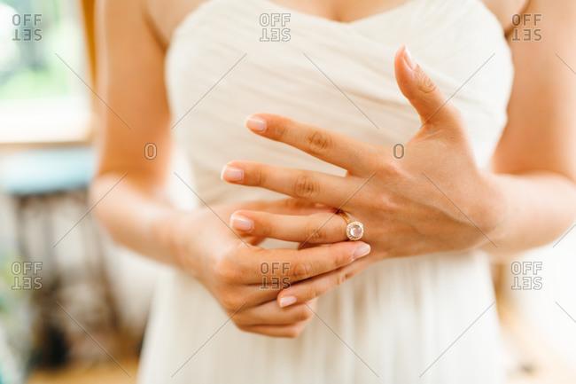 Close up of bride adjusting her wedding ring