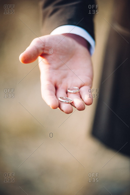 Groom holding the rings at his wedding ceremony