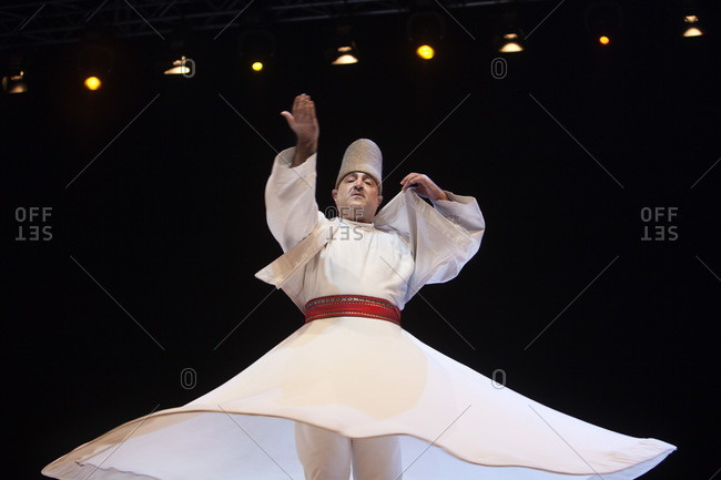 Naples, Italy - October 13, 2014: Dervish dancer in live performance, In Diverso Canto