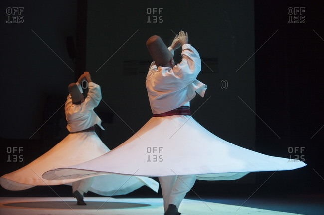 Naples, Italy - October 13, 2014: Dervish dancers in live performance, In Diverso Canto