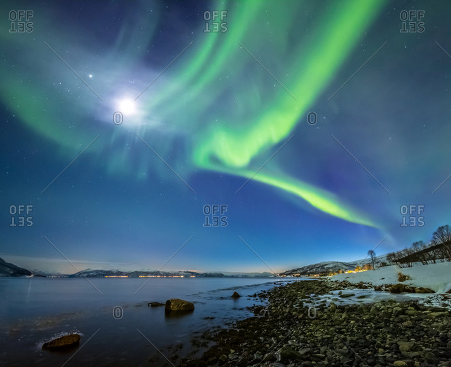 Northern Lights and Moon Over a Rocky Beach, Norway