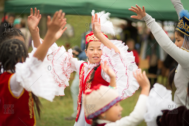 Bokonbayevo, Issyk Kul Province, Kyrgyzstan - August 16, 2014: Kyrgyz Girls and Women Dancing in Traditional Dress During a Nomadic Games Festival, Kyrgyzstan