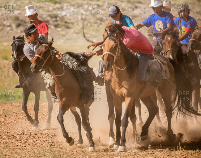Kizil-Oi, Suusamyr Valley, Kyrgyzstan - August 23, 2014: Buzkashi Players Fighting for the Goat During a Nomadic Games Festival, Kyrgyzstan
