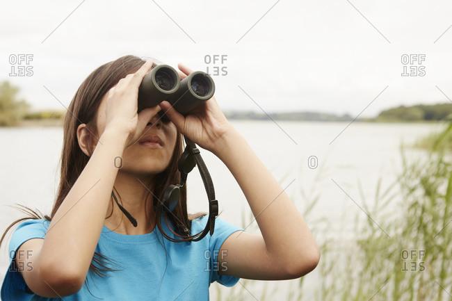 A young  birdwatcher with binoculars
