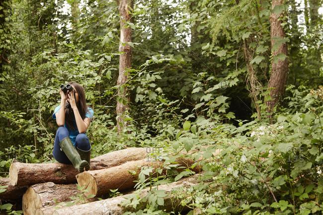A young girl birdwatcher