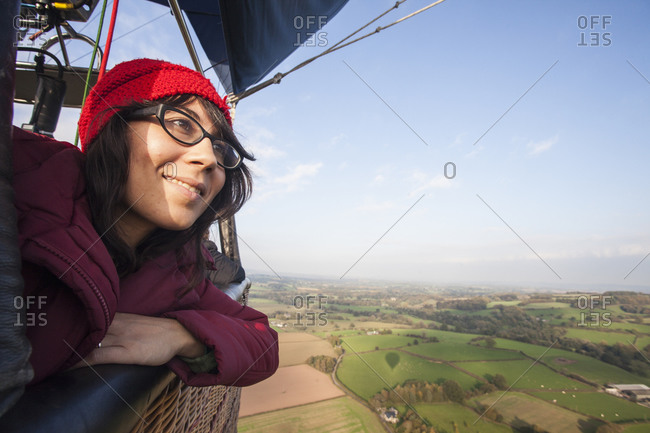 Close up of a woman travelling in a hot air balloon