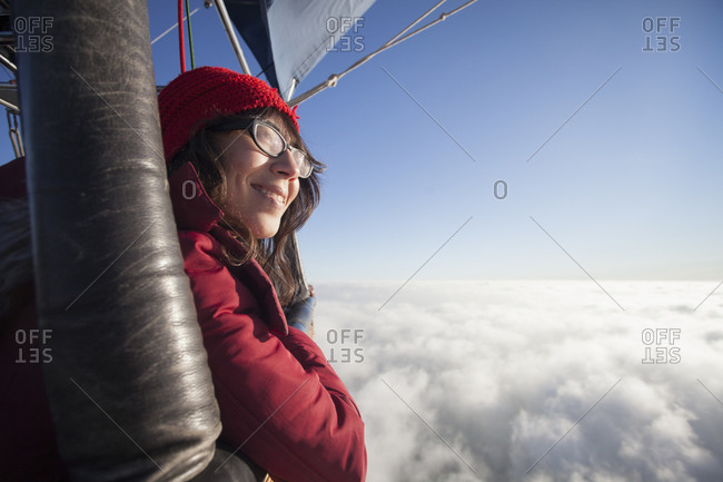 Woman travelling in a hot air balloon