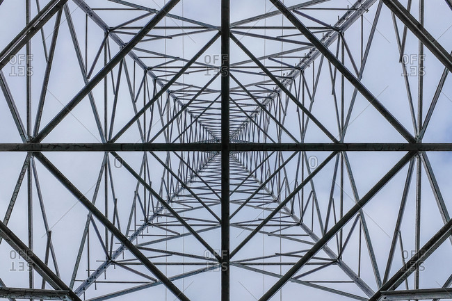 Looking up at a transmission tower