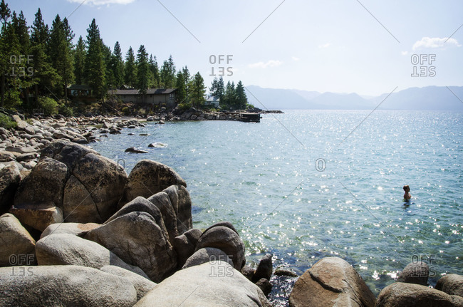 Man submerged in a shimmering lake
