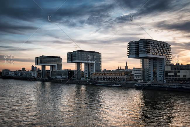 Cologne, Germany: November 4, 2014: View to Crane Houses at Rheinau Harbor at twilight