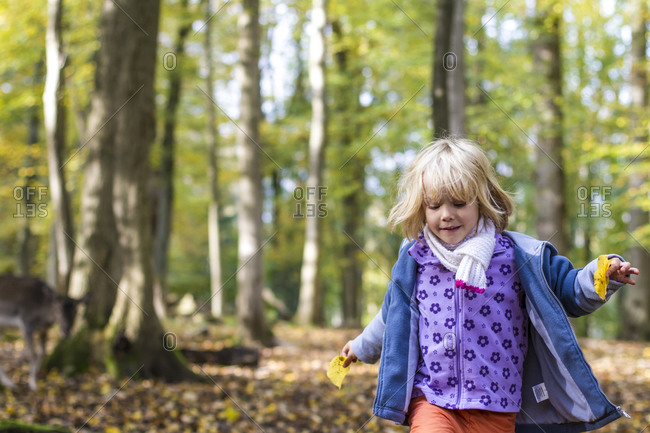 Little girl walking in a game preserve