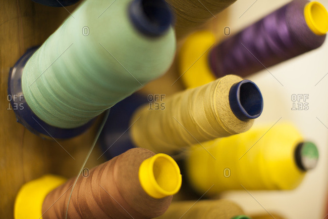 Different spools of a sewing machine, close-up