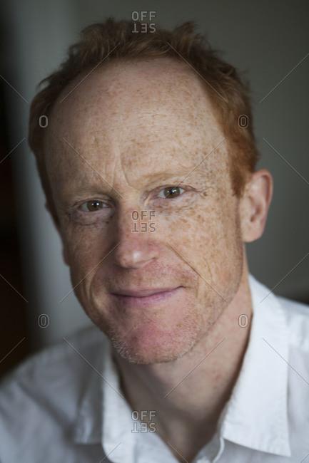 A portrait of a redheaded man