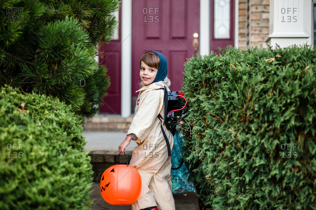 Boy and girl approaching house in costume