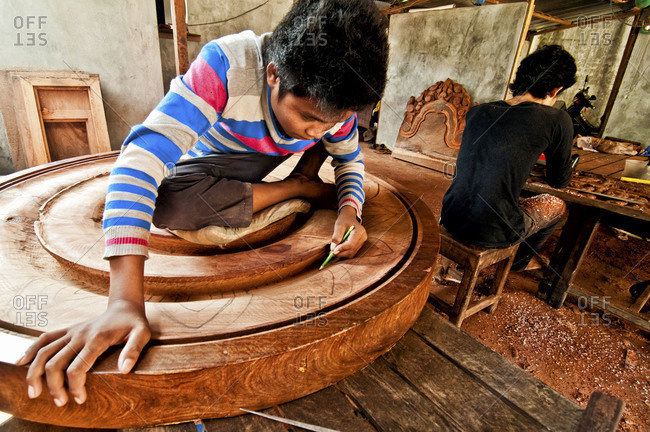 Siem Reap, Cambodia - September 14, 2012: Carpenters working on a table