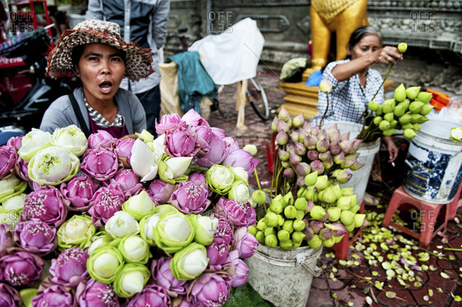 Phnom Penh, Cambodia - October 1, 2012: Woman selling flowers at the market