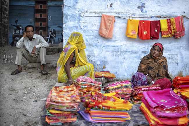 Jodhpur, India - March 7, 2014: Women selling colorful textiles