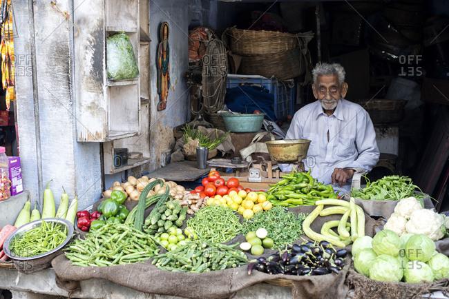Jodhpur, India - March 7, 2014: Vegetable seller at the market in Jodhpur, India