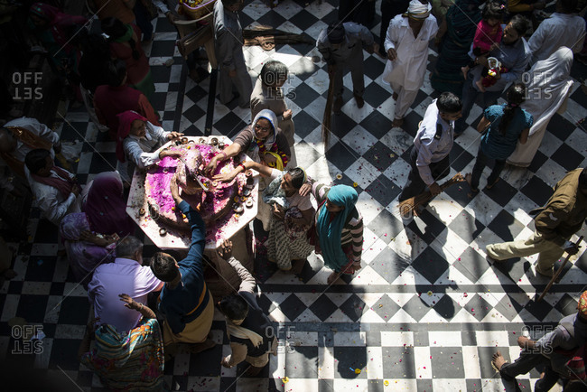 Vrindavan, Uttar Pradesh, India - March 11, 2014: People touching an altar during the Holi Festival