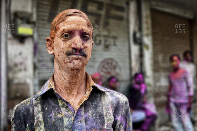 Bikaner, Rajasthan, India - March 17, 2014: Man drenched in paint during the Holi festival