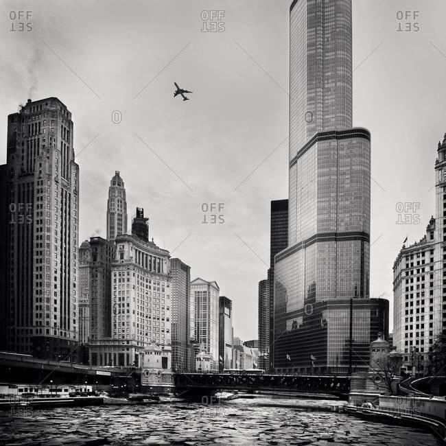Plane flying over Chicago skyline