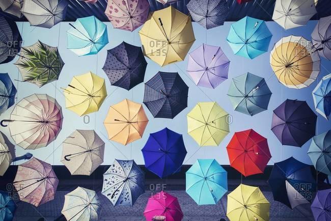Colorful umbrellas hanging between buildings