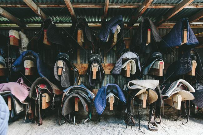 Saddles in a barn