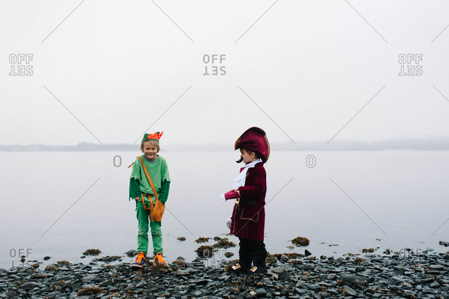 Young boys in costumes standing on a seashore