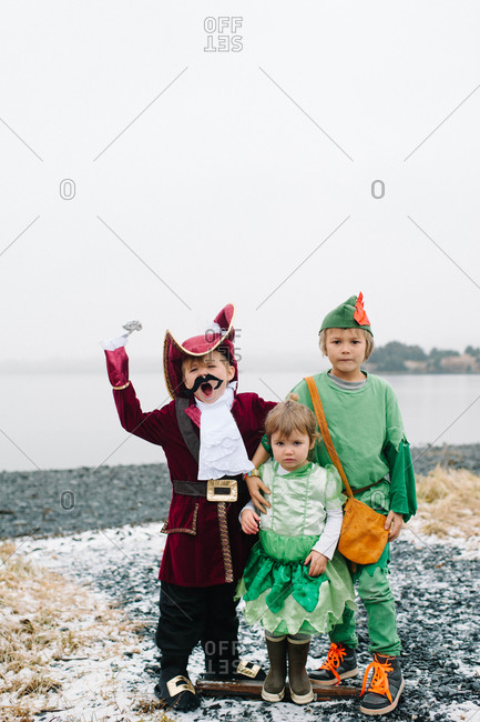 Children in costumes standing on a coast