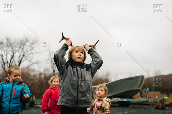 Young boy pretending to be a deer