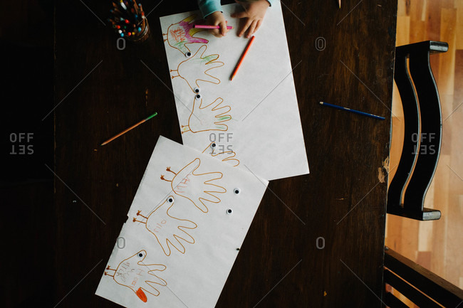 Child drawing Thanksgiving turkey