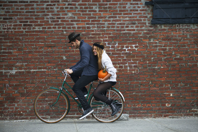 Young man and woman on a bike