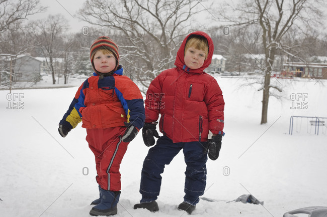 Two boys bundled in snow clothes